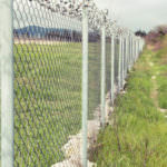 Chain Link Fencing in Grassy Area with All Counties Fence and Supply in Riverside and San Bernardino Counties