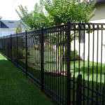 Iron Fencing next to green trees in Riverside and San Bernardino Counties