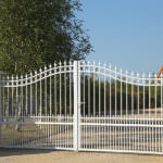 Iron Fencing with gate in front of walkway in Riverside and San Bernardino Counties