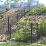 Iron Fencing surrounding a hill in Riverside and San Bernardino Counties